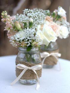 arreglos florales con botellas de vidrio -