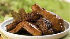 Adobo is the most famous and the quintessential Filipino viand. It may be dry or stew like dish cooked in soy sauce, vinegar, garlic and spices. It is very tasty and delicious. Adobo is typically served with steamed white rice.