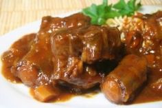 This Oxtail & Butter Beans Recipe is a classic Caribbean dish. It is comfort food at its best and it is a hearty meal made with affordable ingredients. The star ingredients are JCS Oxtail & Stew Seasoning and JCS Spicy Jerk Ketchup. Oxtail Recipes, Cooker Recipes, Cooking Oxtails, Guisado, Butter Beans, Tasty, Yummy Food, Down South, Mets