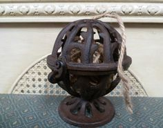 """Cast Iron String Holder -  32.00 This cast iron jute/string holder measures 5 1/2"""" across. It comes with 20 feet of jute. Just open the hinged ball and add your own string etc. Free Shipping"""