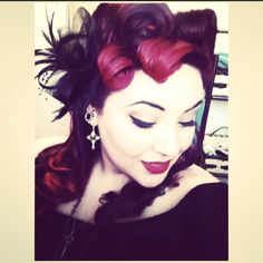 I love the 40's-50's fashion era. Victory rolls, Pin curls, red lips, winged eyeliner, corsets, I love it all! <3