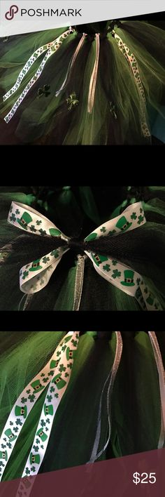St Patrick tutu Skirt 4-8 girls 3 layer black and green St Patrick Day Tutu Skirt. Handmade by me. Has adorable 3 leave clovers all around. Has a rich of silver accent ribbon, as well had ribbon with clovers  ♣️ and hats 🎩 on it. Has a match hair bow as well. Skirt is about 11 inches long. This tutu is perfect to pair with a pair of leggings. Handmade by A & K Pretties Bottoms Skirts
