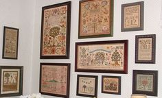 Margaret's Adam & Eve samplers...I die~!  I would love to have a sampler wall like this