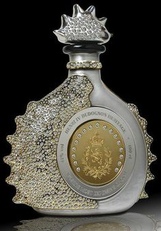 Most expensive Cognac in the world: Henri IV Dudognon Heritage, aged for 100 years in barrels that were air dried for five years before use. The bottle is dipped in gold and sterling platinum, the bottle was adorned with brilliant cut diamonds Alcohol Bottles, Liquor Bottles, Perfume Bottles, Tequila Bottles, Drink Bottles, Bling, In Vino Veritas, Wine And Spirits, Bottle Design