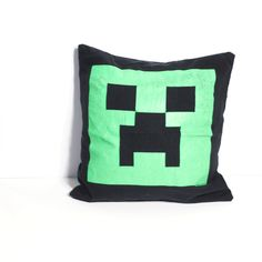 "One of a kind Minecraft pillow featuring a Creeper. - As soft as your favorite tee shirt - 12"" x 12"" pillow - Envelope closure in the back for easy washing and care - Made in the U.S."