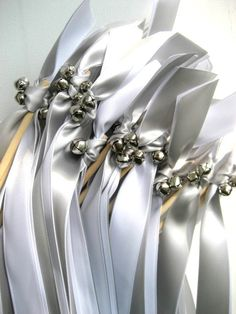 Wedding wands with ribbon and jingle bells for ceremony.