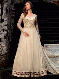 Cream Net Wedding Wear Anarkali Salwar Suit. To View more collection at www.g3fashion.com For price or detail do whatsApp +91-9913433322.