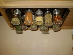 Magnetic Spices; a cookie sheet screwed to the underside of a cabinet, then use hot glue to put magnets on the jar lids!