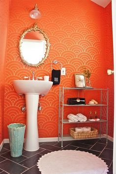 designstILes' powder room, art deco orange/gold wallpaper