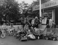 Youngsters queuing at a toy garage in Southall Park, Middlesex, which formed part of a road safety training area.