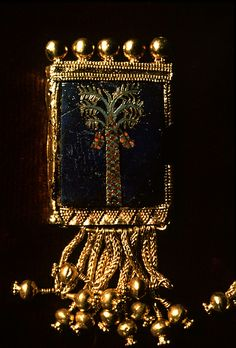 Gold framed pendant,  found at the biblical town of Nimrud .Nimrud was the capital of Ashurnasirpal II. an Assyrian king of the 9th century BC