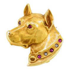 Puppy Dog circa 1910  18 karat yellow gold Victorian dog brooch set with rubies and diamonds.