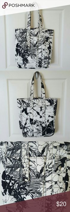 Roxy tote Black and white floral print Roxy tote. In amazing condition for being white and rarely worn. The handles are slightly but barely dirty just from holding the handle. Easy clean. More like off white but not completely dirty or discolored. I can send more photos if needed. The front has two pockets. One larger, the other for a cell phone. Top snap closure and no pockets inside. Length is 15in, width is 12in and base is 3in. Roxy Bags Totes