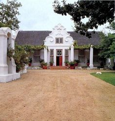 I can imagine a fanciful façade like this on my little waterfront cottage. Cape Dutch Manor House - Morgenster