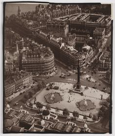 A bromide print photograph entitled 'Trafalgar Square', taken by an unknown photographer, c. This aerial photograph shows the roof of the National Gallery and the streets leading away from Trafalgar Square, London. Vintage London, Old London, London City, 1920 London, Victorian London, London History, Tudor History, British History, Old Paris