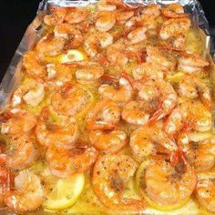 Melt a stick of butter in the pan. Slice one lemon and layer it on top of the butter. Put down fresh shrimp, then sprinkle one pack of dried...