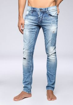 "Super skinny ""Don Giovanni"" jeans in faded denim with rips"