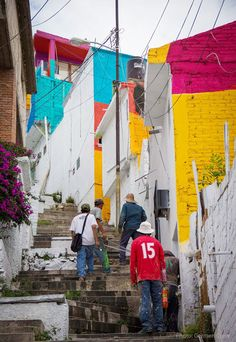 The Mexican government has asked the street artists paint 200 homes to unite the community
