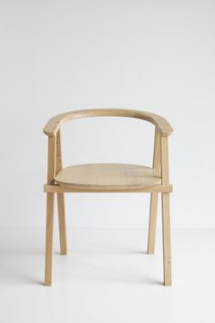 Beam Chair by Oato, made from oak wood and inspired by stacked beam structures.