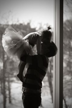 Love this Daddy/Daughter photo with little girl dressed in her ballerina outfit with tutu. One of the things I remember most about my childhood is my daddy getting me ready for ballet class, tutu, bun and all!