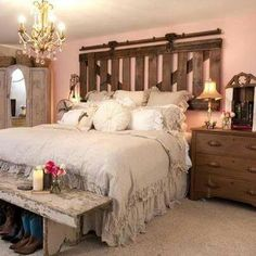 Rustic, masculine elements are still very pretty and romantic around this bed.
