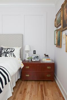 We created wall paneling in our master bedroom for some subtle architectural interest. We used Martha Stewartpebble wall paint, Urban Outfitters monogram pillowcases, frumafargray arrow print headboard fabric, and vintage baker furniture night table.