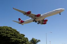 A photo of a Virgin Atlantic Airbus A340-642 airplane landing at Los Angeles International Airport (LAX / KLAX). The aircraft registration is G-VWIN