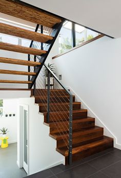 Open staircase with timber treads and wire balustrade