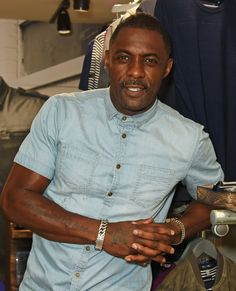 6 Photos of Idris Elba That Will Make You Wish You Were a Short-Sleeved Denim Shirt