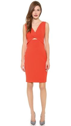 Orange Robert Rodriguez Cutout Dress with black and white pumps, interesting.