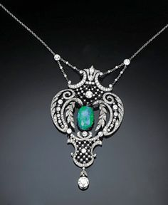 A Belle Epoque Diamond And Black Opal Pendant   The central black opal within delicate openwork garland scrolled surround suspending circular-cut diamond to the fine link back chain, circa 1910, in red leather fitted case, 25.5 cm. long