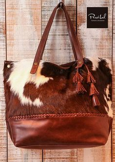 This cowhide and leather bag is perfect as your everyday bag, which can fit for a laptop, an Ipad, files, books, magazines, as well as many accessories.  Materials: genuine Premium brown leather and genuine hereford cowhide (both sides).  The third and fourth pictures are only for inside details reference, this is the same bag in matte black leather.  IMPORTANT: DUE TO THE VARIATION IN COLORING OF EACH COWHIDE, THE BAG YOU RECEIVE WILL BE SLIGHTLY DIFFERENT THAN THE PHOTOS SHOWN. EACH BAG IS…