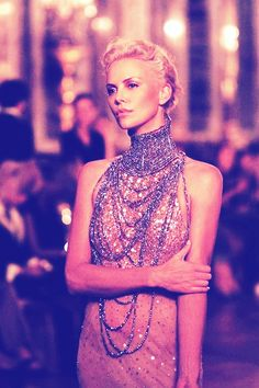 Charlize Theron dripping in high fashion diamonds
