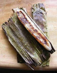 """TUPIG 2 cups glutinous rice flour 1 cup shredded coconut 3/4 cup coconut milk 1/2 cup brown sugar banana leaves cut to 3"""" in width for wrapping.   Combine all ingredients (except the banana leaves) and mix to form a dough. Put a tablespoonful of dough in a banana leaf; spread evenly and wrap. Immediately place in a charcoal or any grill once you wrap one, cook by turning frequently. Once the banana leaf is charred on all sides remove it from the grill then set aside to cool before serving."""