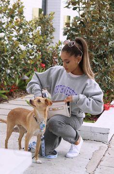 Ariana Grande Walking her dog wearing Northwestern sweatshirt and Coach Swagger Wristlet bag