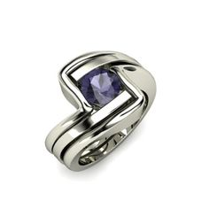 The Ocean ring with an iolite center stone, and two all-metal matching bands, one on either side!