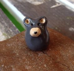A personal favorite from my Etsy shop https://www.etsy.com/listing/290054741/miniature-polymer-clay-brown-bear