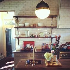 Rachel Halvorson designs  Love love love this kitchen...Hicks lighting; subway tile to the ceiling, wood counters and open shelving.  plus the black door too  :)