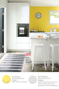 Benjamin Moore's 'Banana Yellow paint color provides a fun burst of color in this modern kitchen. Yellow Paint Colors, Room Paint Colors, Hemnes, Yellow Accent Walls, White Wall Decor, Benjamin Moore Colors, New Kitchen, Kitchen Ideas, Kitchen Yellow