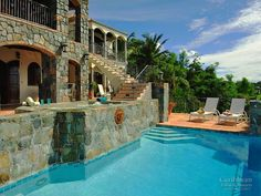 Casa Del Sol is a gorgeous plantation style home designed in traditional Caribbean style with native stone, antique brick and much more! Plantation Style Homes, Resort Villa, Coastal Decor, Vacation Spots, Porches, Cottages, Caribbean, The Neighbourhood, National Parks