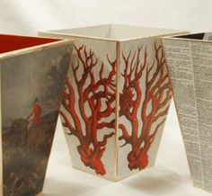Decoupage wastebaskets with old book pages