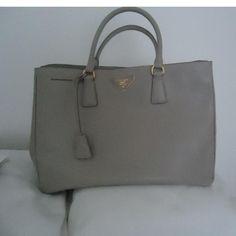 Tip: Prada Handbag (Light Grey)