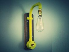 Made from steel, this unique handmade yellow industrial tap wall light with brass switch is ideal for adding a stylish edge to your home. This light is also available in 5 different colours options, which are: Natural - Steel Black Red White Cyan  These have all been added to my shop individually so please take a look.  Measurements - L x 42cm, W x 8cm, D x 24cm  Bulb The vintage Squirrel Cage BC light bulb (pictured) will be provided with the light.  The light is fully wired, PAT tested…