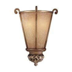 "Jessica McClintock Grand Salon 15"" Pocket Wall Sconce by Minka Lavery. $119.90. This well-balanced Grand Salon wall sconce is from the Jessica McClintock Home Collection by Minka and features a deep bronze finish with a Florence patina. Soft leaf pattern accents around the finial complement the spines running up the sides. Luminous salon scavo glass creates a gentle, warm light radiance.. Save 33%!"