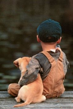 Sharing the simple pleasure fishing with a new generation .. son boy pup dog