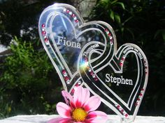 www.cakesteelstanding.co.uk Our Own design Entwined hearts With Swarovski Crystal color of your choice.