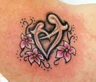 mother and daughter tattoos - Google Search  I like the design around it. The flowers around the heart