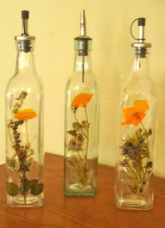 Oil bottles hand-decorated with pressed flowers and herbs make a unique, one-of-a-kind gift.
