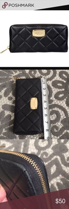 Michael kors black gold leather zip around wallet Beautiful Michael kors black leather quilted zip around wallet with gold hardware. Shows a little bit signs of wear on corners as shown in pictures but overall great condition! Michael Kors Bags Wallets