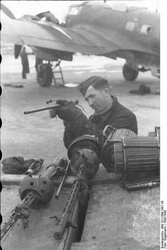 France on the Channel Coast winter 1942 . Aircraft armorer checks on-board…
